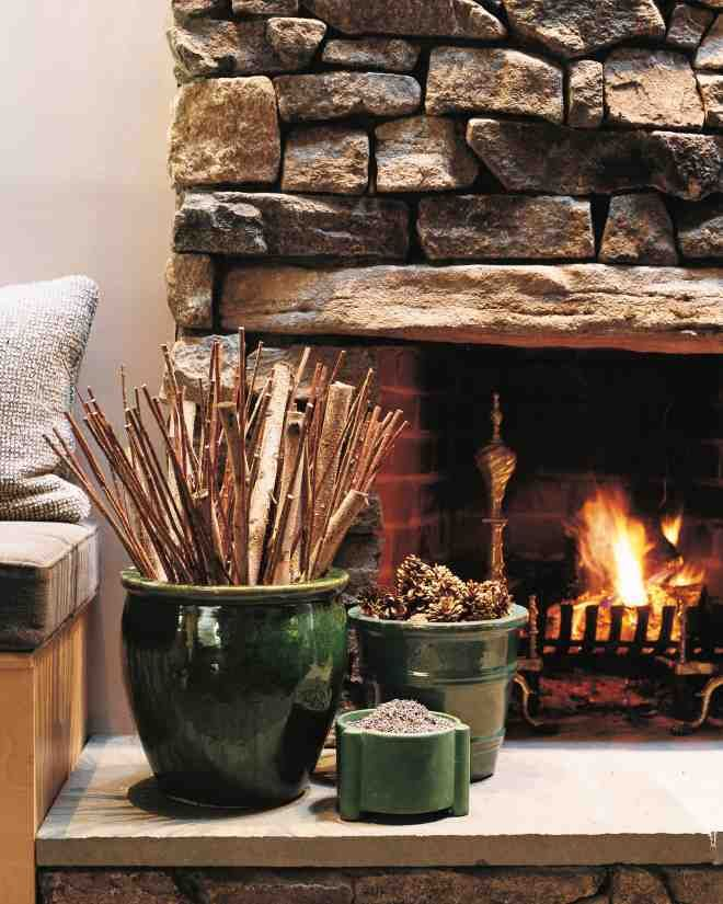 Good-looking garden planters don't have to hibernate all winter. Arranged along a hearth, the containers take their turn as eye-catching elements indoors. In glazed terra-cotta or another heat-resistant material, the pots provide a perfect place to stow split logs, kindling, and aromatic enhancements, such as dried lavender and pinecones.