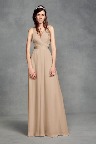 Featuring a plunging V-neckline and alayered chiffon-over-tulle skirt for a little fullness, this White by Vera Wang bridesmaid dress makes a style statement with a bold tulle bow at the nape of the neck.  White by Vera Wang, exclusively at David's Bridal  Polyester  Back zipper; fully lined  Dry clean  Imported