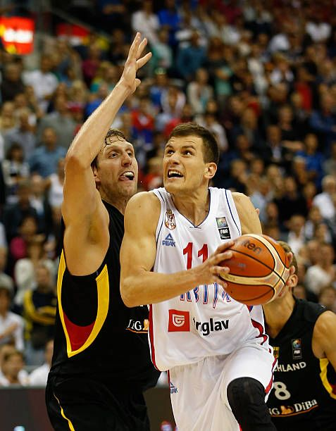 Nemanja Nedovic of Serbia drives to the basket against Dirk Nowitzki of Germany during the FIBA EuroBasket 2015 Group B basketball match between...