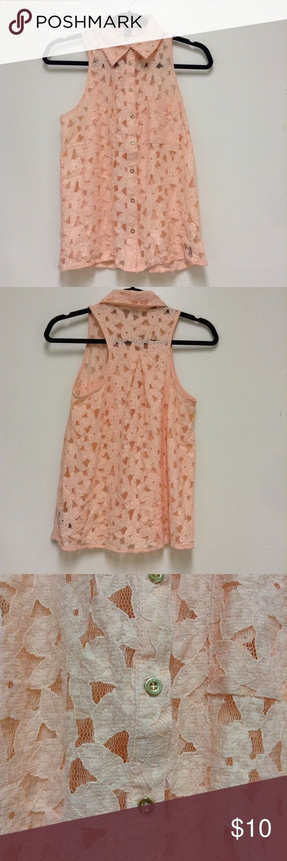 Forever 21 Peach Sleeveless Top Forever 21 Peach Sleeveless Top. Has gold colored buttons. The material is a peach Lace/Mesh made up of a floral design. The back is cut like a razorback. It is see through. Worn twice. Forever 21 Tops Button Down Shirts