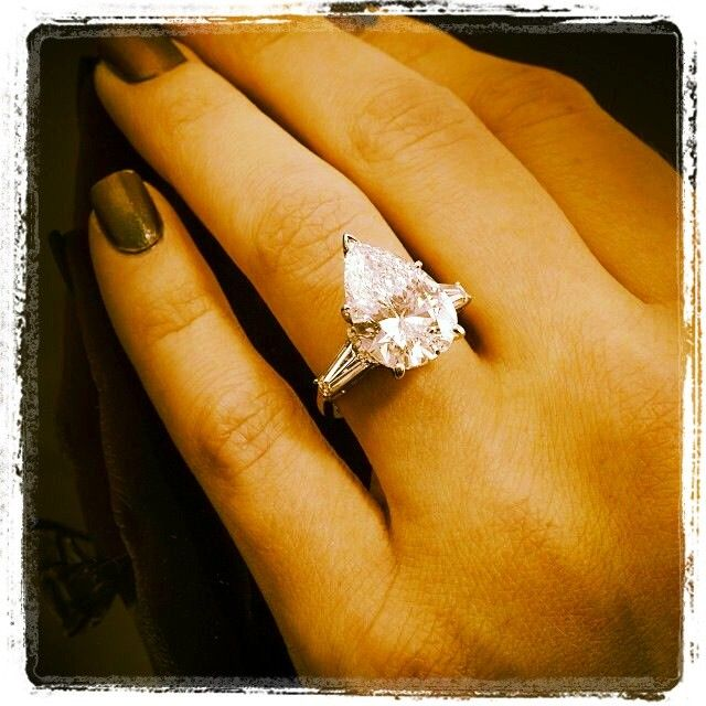 Pear-shaped diamond with taped baguettes engagement ring. DIAMONDMANSION.com