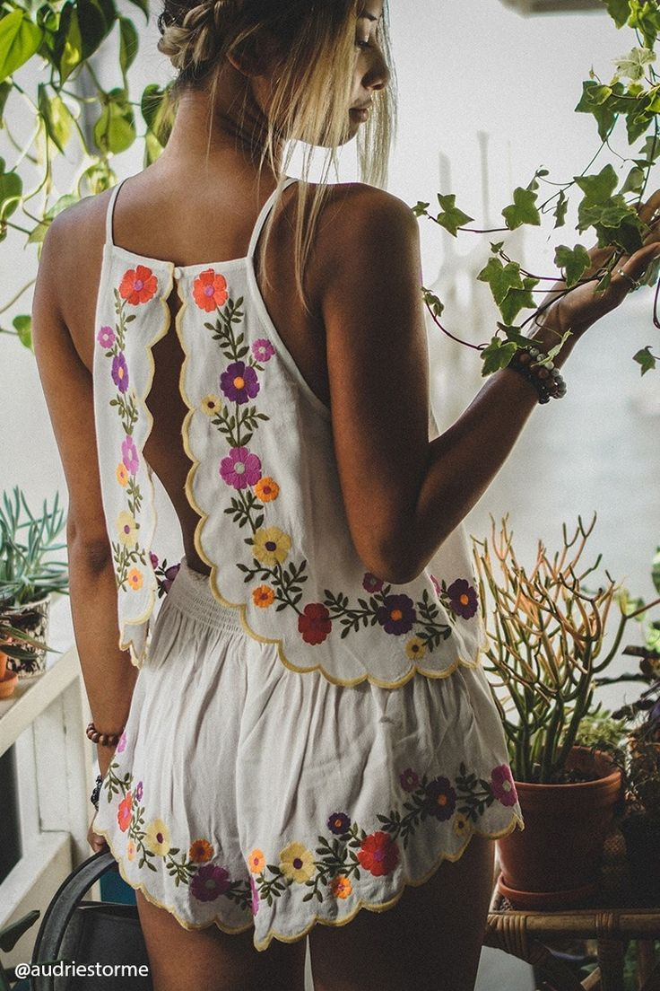 A crepe woven cami featuring a floral embroidered design, split tulip back, scalloped trim, and a square neckline. Matching bottoms available.