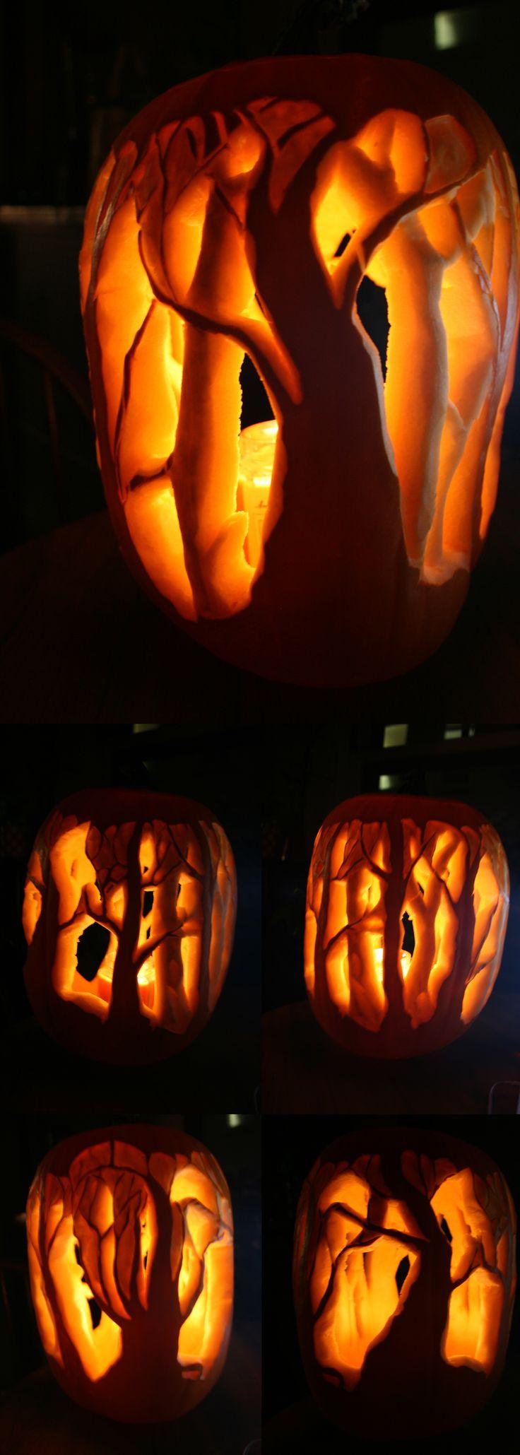 carved pumpkin halloween art forest trees