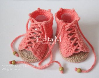 Crochet baby sandals. Made from acrylic yarn. Size : 3-6 months. Length: approx. 10 cm.- 4 inches  Hand wash in cool water.  You can find me on Facebook:…