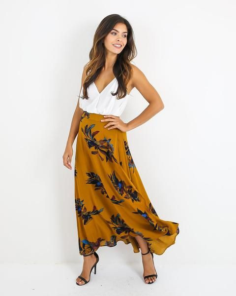 One of our most coveted prints, now available in a gorgeous maxi skirt! Our Elk Wrap Maxi Skirt is beautiful in a true wrap waist that ties to the side to fit you perfectly! We love the natural front