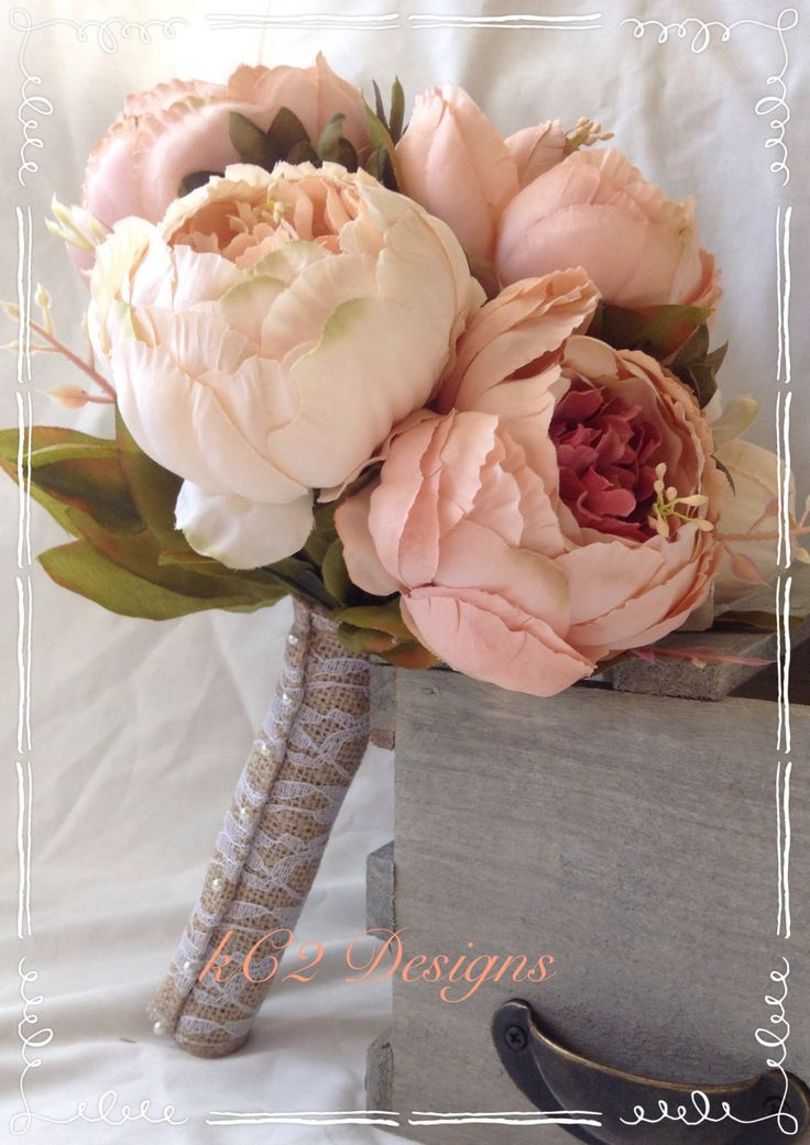 This is a stunning bridal bouquet!! Perfect for any wedding. The blush and ivory silk peonies in this bouquet are amazingly soft to the touch and very life like! The bouquet shown has a lace covered b