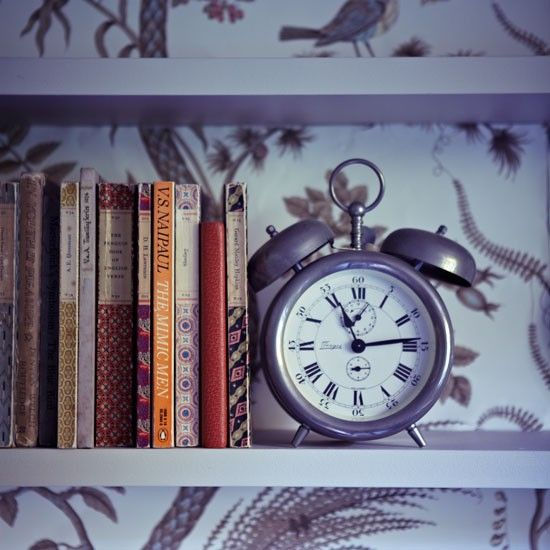 Old-time clock and well-worn books