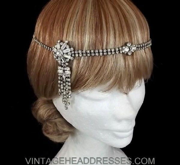 Fabulous vintage forehead band with side dropper detail, created from a wonderful 1930's double-strand diamante necklace piece, with exquisite 1940's side dropper piece featuring masses of sparkling diamante chain strands. Finished with a slim fully adjustable silver chain and clasp at the back, for the perfect fit.