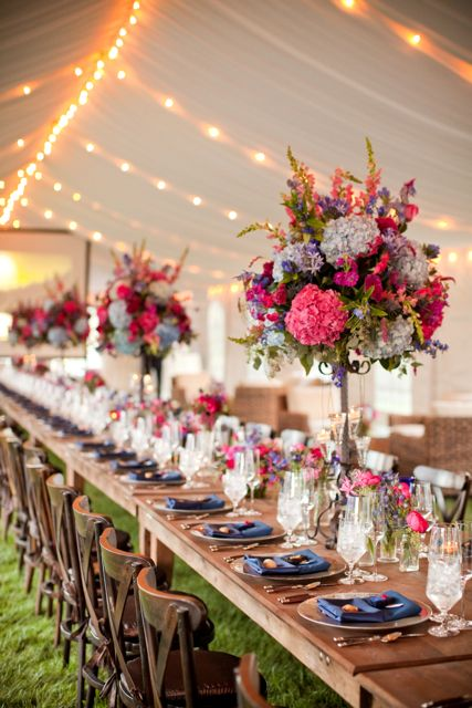 Long Table Featuring Fuchsia And Navy Tall Arrangements
