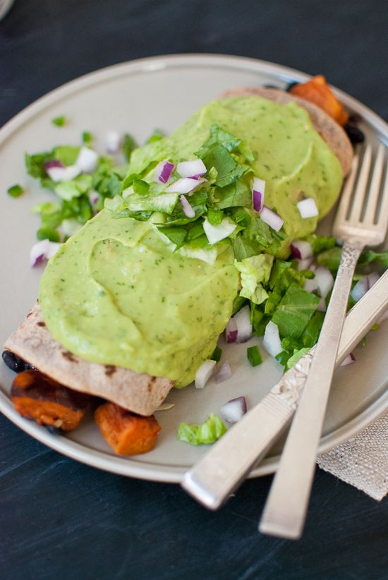 Sweet potato burrito smothered with avocado salsa verde from cookieandkate.com