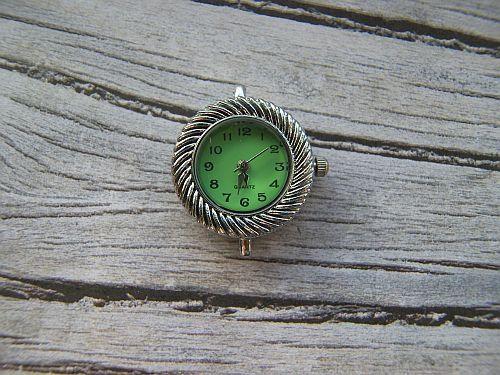 Horloge kastje met groene wijzerplaat.   www.xitin.nl