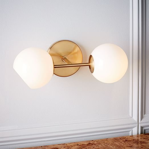 Staggered glass sconce antique brass milk 2 light