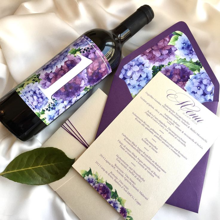 Hydrangea wedding menu and wine bottle as table numbers set to make your wedding dinner so special and cohesive.  . . . . . #weddingdecor #weddinstationery