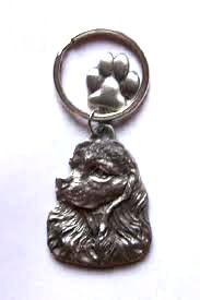 Cocker Spaniel keyring with lovely paw charm, made from finest pewter. Authentication stamp of U.S manufacturer on reverse. Available in UK - price includes VAT & UK postage.