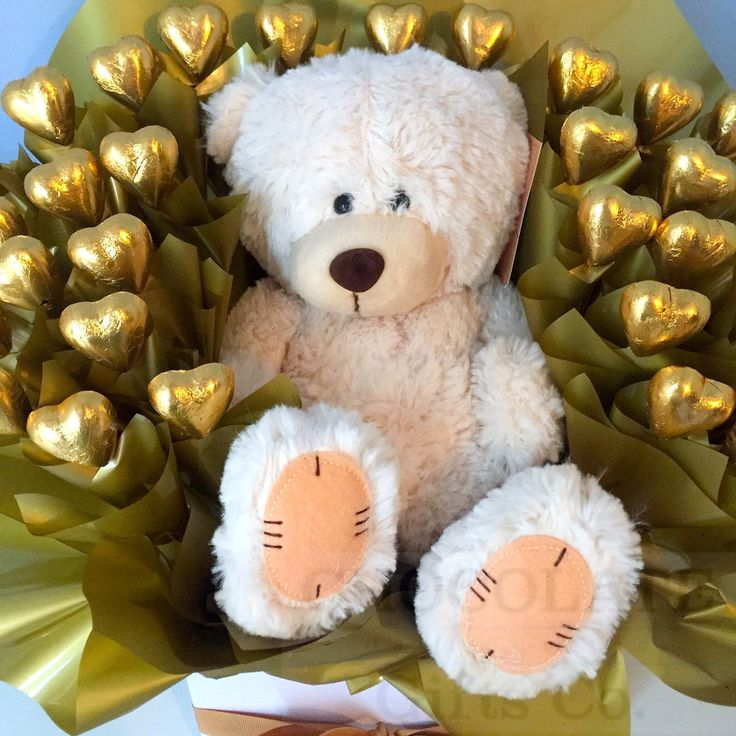 An arrangement of 30 Australian made quality Chocolates that will not disappoint. This box gold love hearts will steal the heart of your loved one. With a added teddy bear sitting in the centre this gesture will be one that they will not forget. Whether it be a friend, partner or family member show them what they mean to you. The perfect chocolate gift!