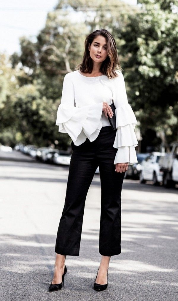 tiered ruffled sleeves with a pair of smart trousers and pumps