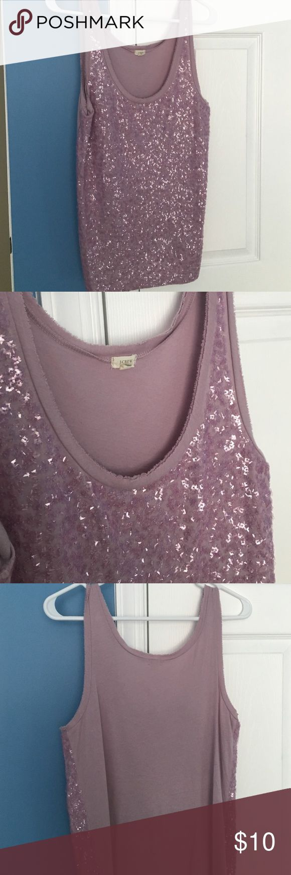 Jcrew sequined jersey tank Reposhing because I just haven't worn it much...I feel too old for the sequin detail :) But it is the cutest  scoop neck cotton tank in lavender with frayed edge style on neck and arms and square sequins. Very good condition fits loose so would be good for 6-8 J. Crew Tops Tank Tops
