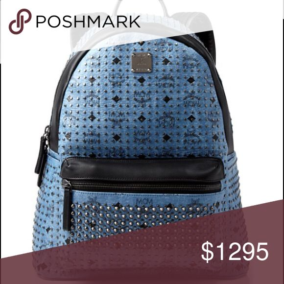 "MCM Stark Special Medium Backpack Defined by MCM's iconic logo pattern and edgy studded details, this roomy blue backpack from the luxury leather designer is an effortless blend of sophistication and rock-and-roll flair.                                 Coated canvas Imported Top handle, adjustable shoulder straps Double zip closure for main compartment, interior laptop pocket, interior zip pocket, front zip pocket Logo monogram, studded detail throughout, silver-tone logo tag at front 13"" x…"