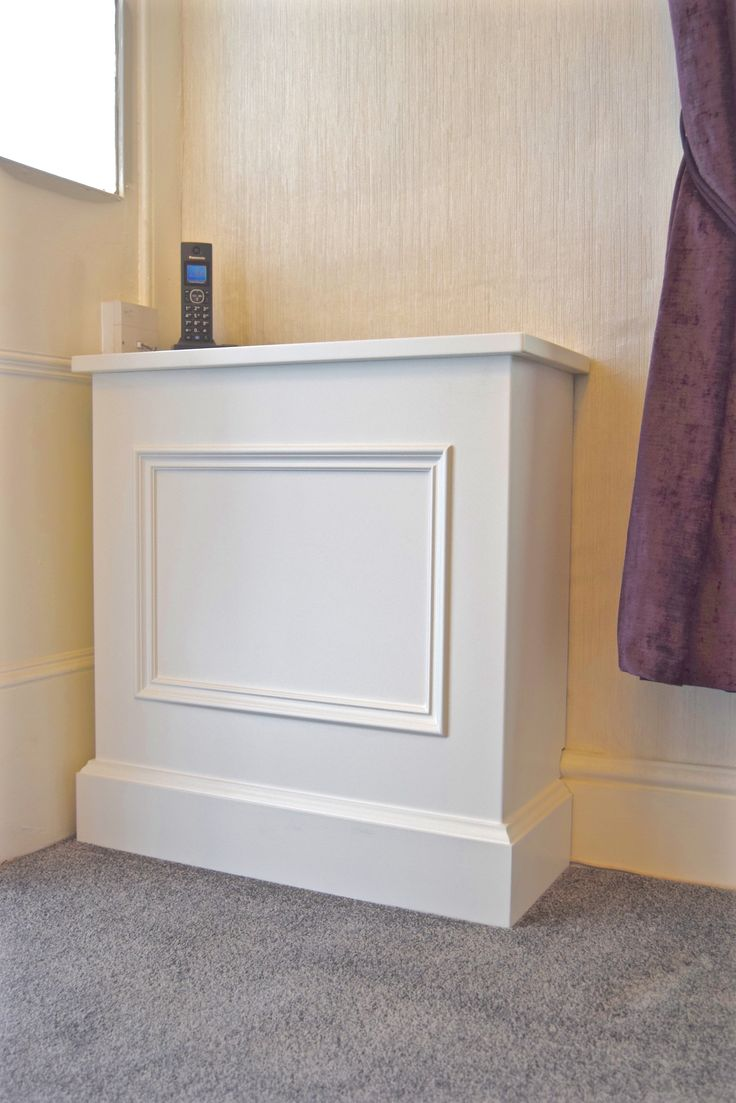 Semi fitted meter reader cabinet (removable for easy access) to match the fitted alcoves. Gill Martinez- Cabinet Maker. Manchester, England. www.gillmartinez.com