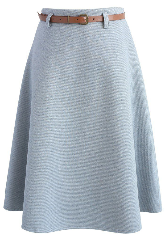 A mild slay is in the forecast today Chicwishers! This wool-blend A-line skirt offers a dose of subtlety and simplicity with its soft dusty blue hue and stylish skinny belt.  - Belt accompany - Concealed back zip closure - Lined - 35% Wool, 65% Viscose - Hand wash  Size (cm) Length Waist  XS       67     66   S        67     70   M        67     74   L        67     78  Size (inch) Length Waist  XS       26.5    26  S …
