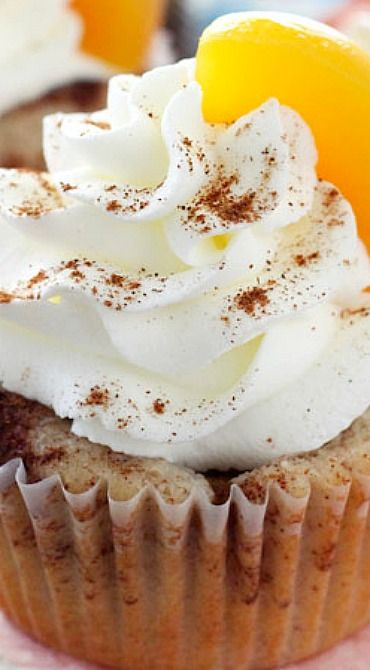 Peach Cobbler Cupcakes ~ Full of cinnamon and peaches and topped with whipped cream