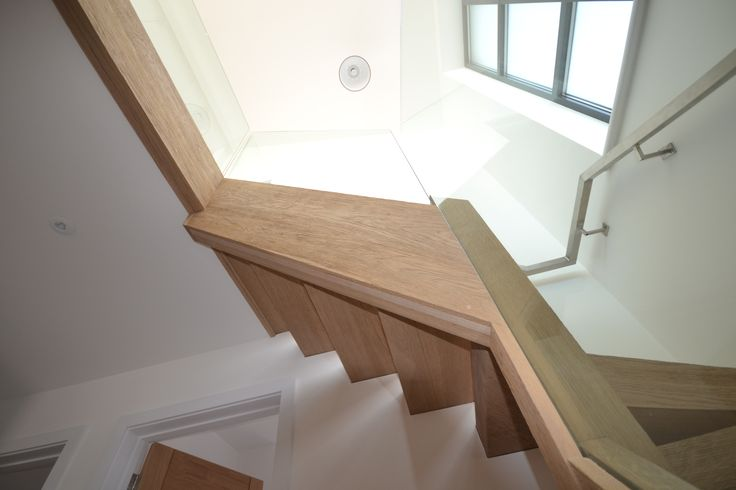 Modern oak staircase with glass balustrade - we love how much our customer's personal styles vary!