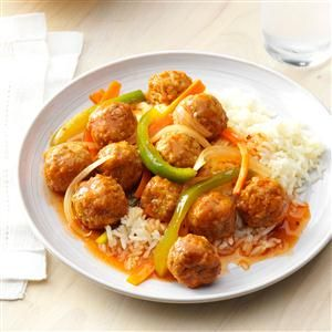 Dressed-Up Meatballs Recipe -Frozen meatballs and a jar of sweet-and-sour sauce make this microwave meal a last-minute lifesaver when racing against the clock. The flavorful sauce is dressed up with a hint of garlic and nicely coats the colorful mixture of meatballs, carrots, green pepper and onion. —Ivy Eresmas, Dade City, Florida