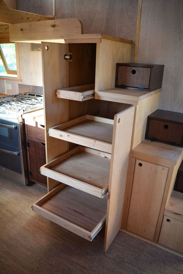 Kitchen storage in a staircase in a tiny house.