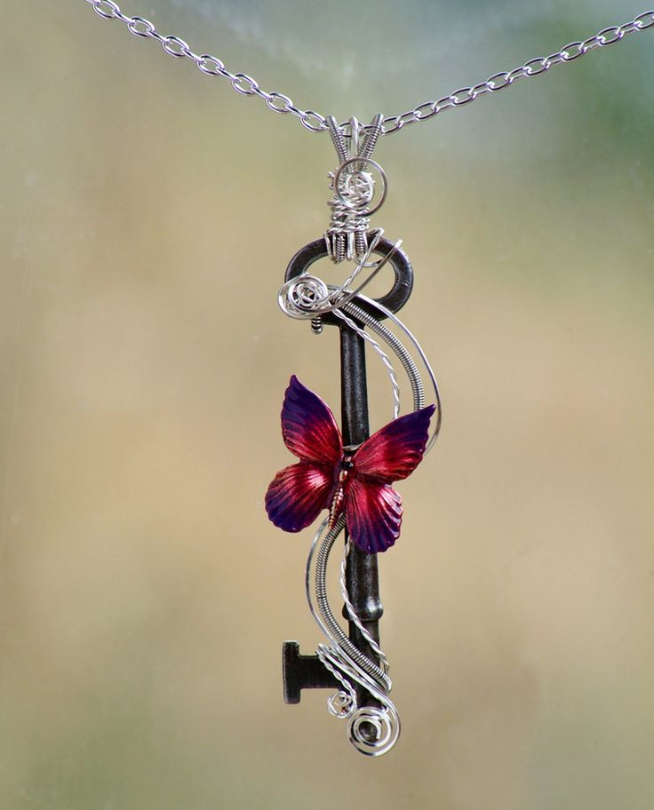 Antique Skeleton Key Butterfly Necklace, wire wrapped skeleton key, coiled wire, purple and red butterfly. $45.00, via Etsy.