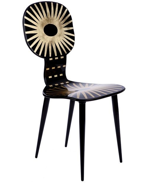 Black and gold 'Raggiera' lacquered wood chairs from Fornasetti  / L'Eclaireur