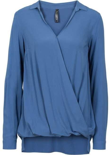 Jetzt anschauen: Schöne Bluse in Wickeloptik, mit figurumspielender Passform und leichten vokuhila-Details.