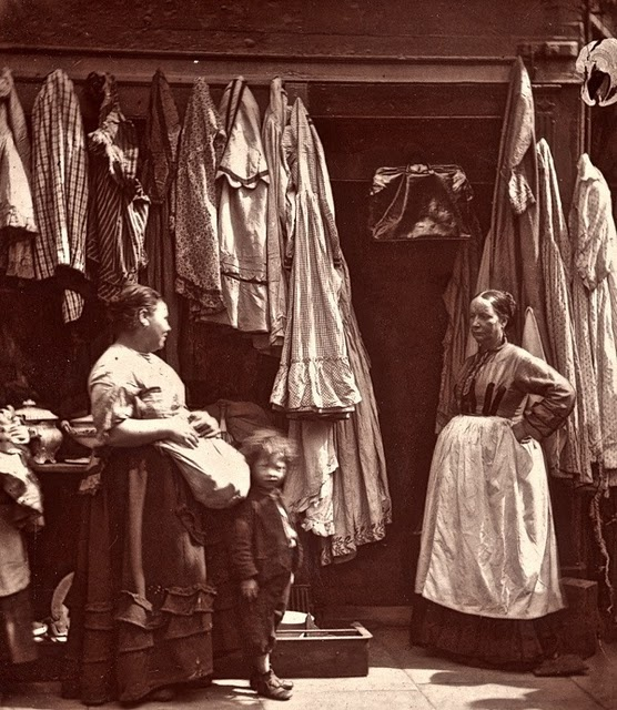 """Vintage John Thomson photograph Old Houndsditch Rag Fair (original posting Spitalfields Life, a fascinating blog) In 1503, when Houndsditch was first paved over, it was already the haunt of brokers and sellers of old apparel. Ben Jonson refers to it in """"Every Man in His Humour,"""" first performed at the Curtain Theatre in Shoreditch in 1598 - Wellbred: Where got's thou this coat? Brainworm: Of a Houndsditch man, Sir, one of the devil's near kinsman, a broker. (courtesy, ..."""