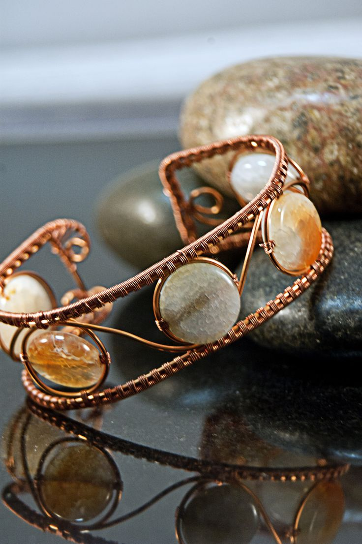 These lovely light blue and sun kissed orange 16 mm Sun Agate disks are fashioned into a 24 mm (1 inch) wide bracelet made from sealed wire woven copper wire.