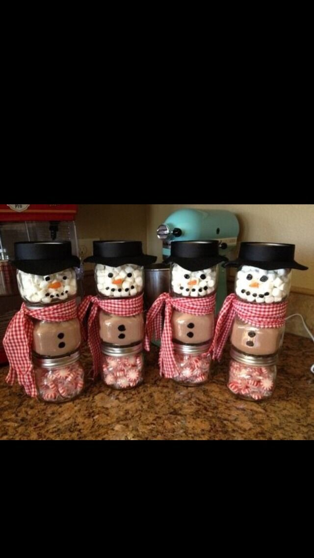 Cutest Christmas Present For Friends And Family ❤️❤️What you'll need: 3 small clear jars Pre-wrapped miniature peppermints Hot chocolate mix Miniature marshmallows Black felt Red plaid fabric Black sharpie Orange sharpie Hot glue gunStep 1- Get 3 small jars, mason jars would be my choice. Cheap, durable ones can be bought here http://www.save-on-crafts.com/ball-jars-collection-elite-pint-4ct.htmlStep 2- With the black and orange sharpie, draw the dots for the snow man on...