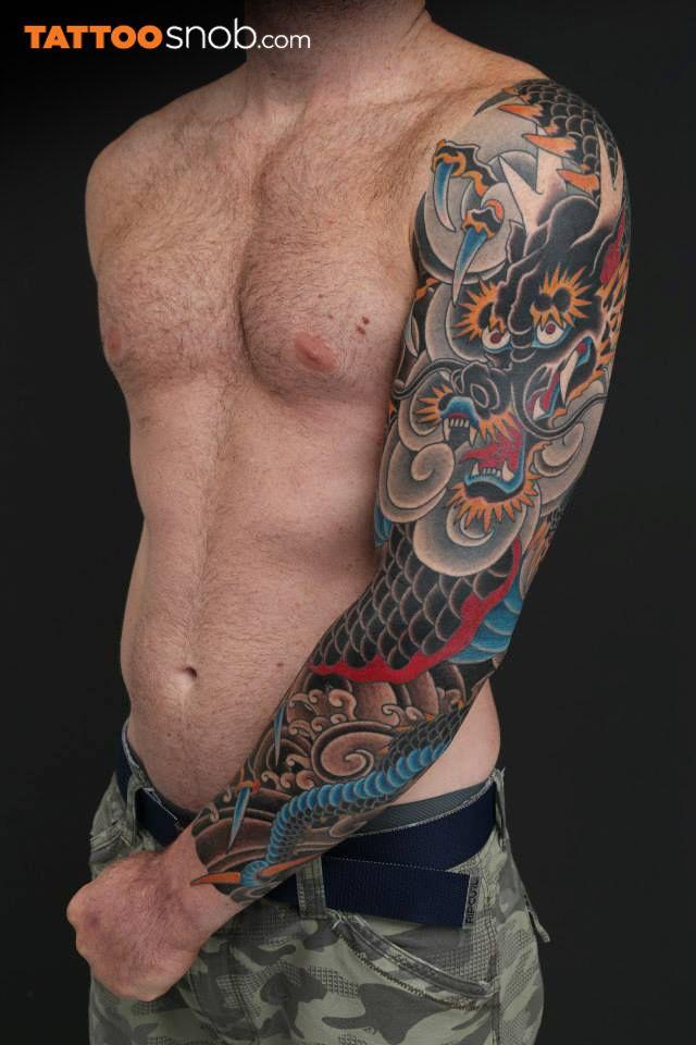 Dragon sleeve tattoo by EN (aka Horizaru Tokyo) in Kita-ku, Tokyo, Japan.