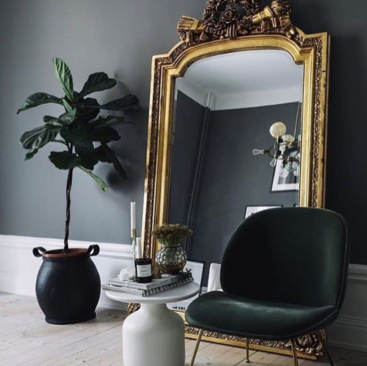 Dark grey walls and beetle chair in dark green-the perfect combo nation! -10 Beautiful Rooms - Mad About The House