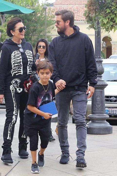 Scott Disick wearing Saint Laurent Original Low Waisted Skinny Jean in  Washed Grey Stretch Denim and