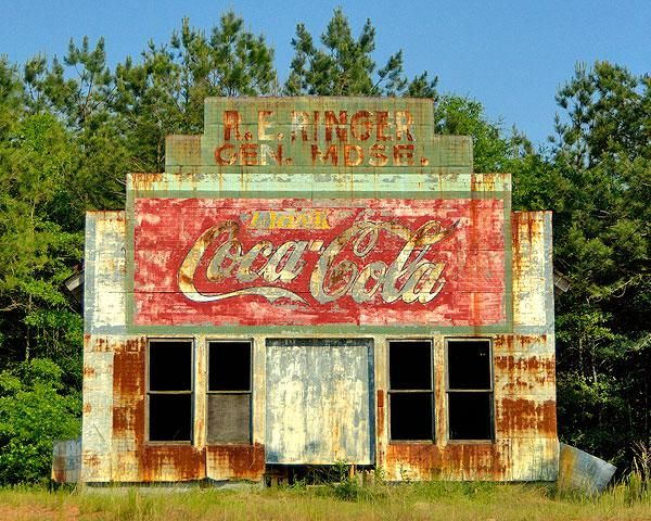An old, abandoned general store in Carrollton, Georgia, not far from where I live.  I love the rust and the faded Coke sign.  A beautiful picture of happier days in my beloved South.