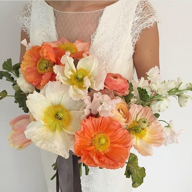 An eye popping poppy bouquet, a perfect with your Amy Kuschel wedding gown!