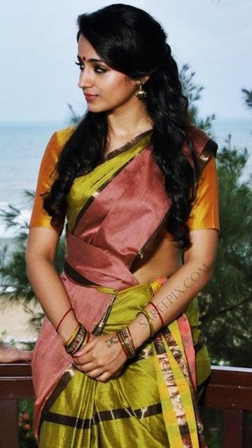 "Trisha latest beautiful sarees in ""yenthavaadu gaani"" movie. The cute tamil actress is gorgeous in plain multi color sarees in the telugu dubbed tamil movi"