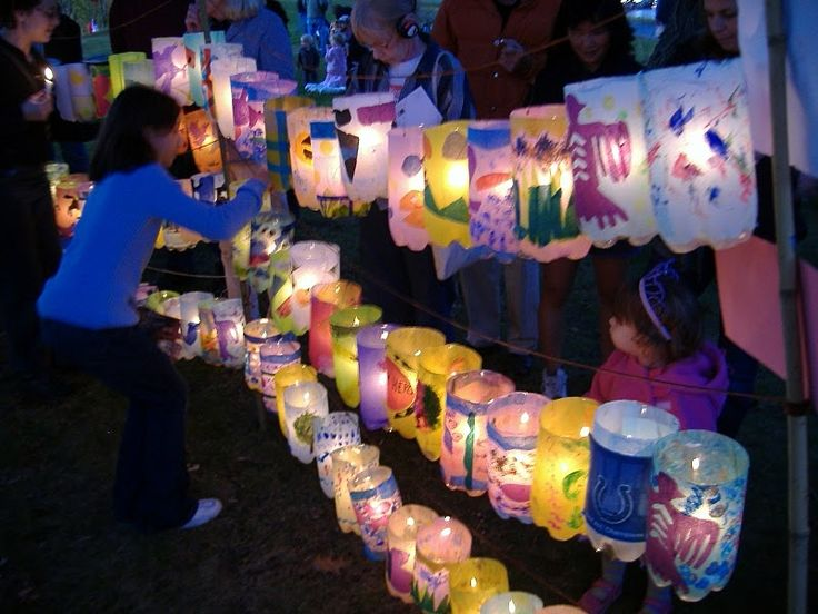 Soda bottle lanterns! Cut the top off a 2-liter soda bottle. Take off label. Decorate with tissue paper put on with watered down Elmer's glue. Punch two holes on top and string wire or string for a handle. Put a battery operated tea light or glo-stick inside.