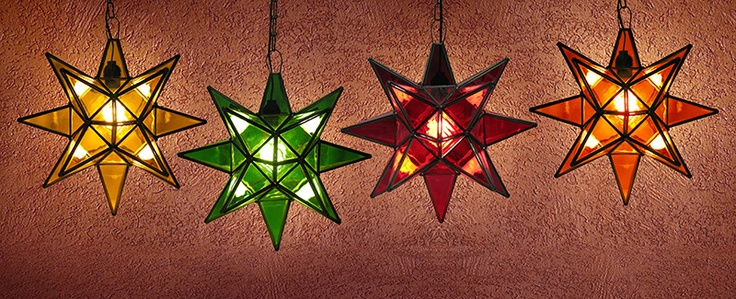 Glass Hanging Lights upscale any room.  These handmade hanging tin and glass stars from Mexico are the ultimate accent to your rustic or southwestern décor! The various glass plate finishes are absolutely stunning when illuminated and glow from every angle. Available in small and large sizes.