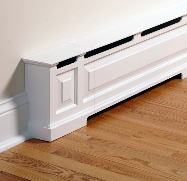 A baseboard heater turned into room trim with a cover by OverBoards.