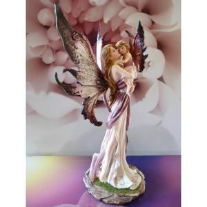 Figurine fée rose avec petite fille