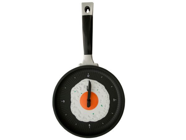 """Egg Frying Pan Novelty Clock, 1 - Perfect in any kitchen, this Egg Frying Pan Novelty Clock features a blue pan-shaped clock with a fried egg in the middle and a fork and knife for hands. Measures approximately 7"""" in diameter x 14"""" long. Requires one 'AA' battery (not included) . Comes packaged in an individual box.-Colors: black,white,green,blue,orange,silver. Material: metal,plastic. Weight: 1.1/unit"""