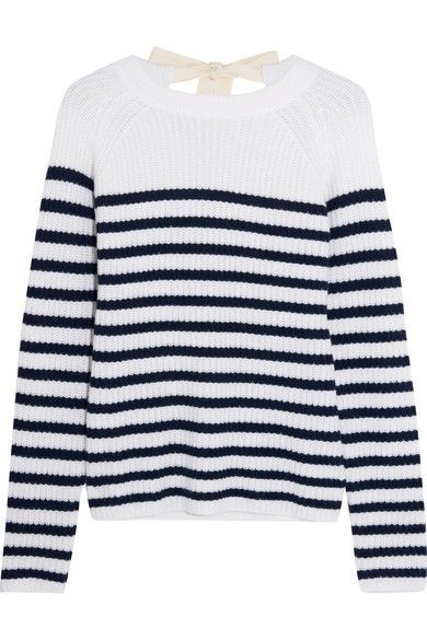 Joseph re-imagines the classic Breton top in soft ribbed cashmere. It turns to reveal a cream herringbone canvas tie that fastens into a feminine bow and drapes low down the back. We like this sweater with tailored pants and jeans.