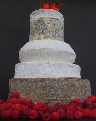 This simple cake, approximately 7.5 kg in weight comprises from top to bottom:   Tunworth or Kelsey lane.  Suffolk Blue.  Sharpham Rustic- a...