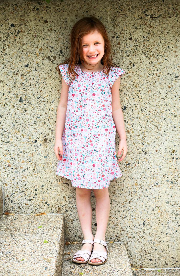 Happy in her Flutter Me Happy Play Dress.  Modern Vintage Clothing for little girls. Spring Flower Floral Dress.