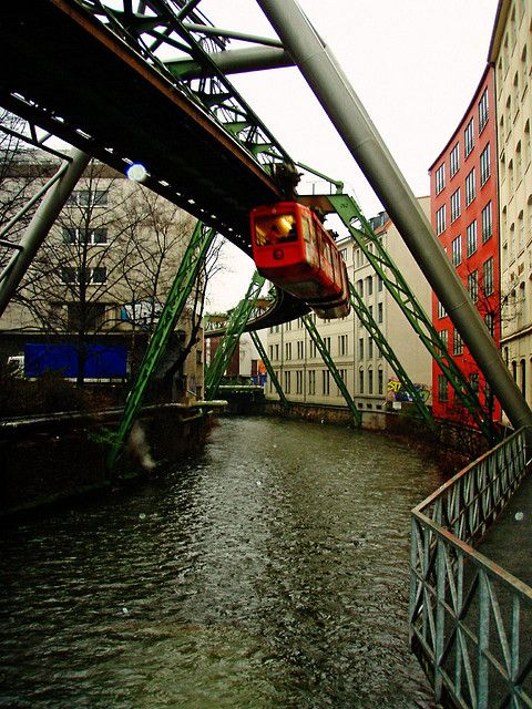 """Wuppertal, Germany The Schwebebahn Wuppertal is a suspension railway in Wuppertal, Germany. Its full name is the """"Eugen Langen Monorail Suspension Railway"""" (Einschienige Hängebahn System Eugen Langen). The people of Wuppertal know it, however, as the """"Old Lady"""" (""""Alte Dame"""") or the """"Steel Dragon"""" (""""Der stählerne Drache""""). Designed by Eugen Langen, who originally planned to build it in Berlin, it was built in 1900, opened in 1901 and is still in use today as a local transport system in the…"""