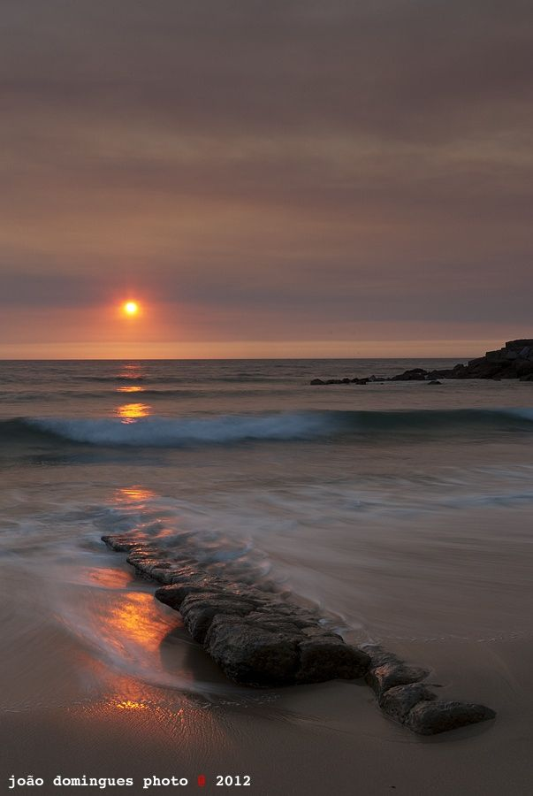 Shot at Praia do Magoito, Sintra, Portugal #Magoito #Sea #Colour #Rocks #Wave #Fire Sky #Reflexion #Slow Motion #João Domingues #Sky